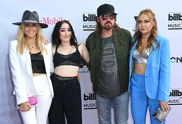 "<div class=""meta image-caption""><div class=""origin-logo origin-image none""><span>none</span></div><span class=""caption-text"">Tish Cyrus, from left, Noah Cyrus, Billy Ray Cyrus and Brandi Glenn Cyrus arrive at the Billboard Music Awards. (Richard Shotwell/Invision/AP)</span></div>"