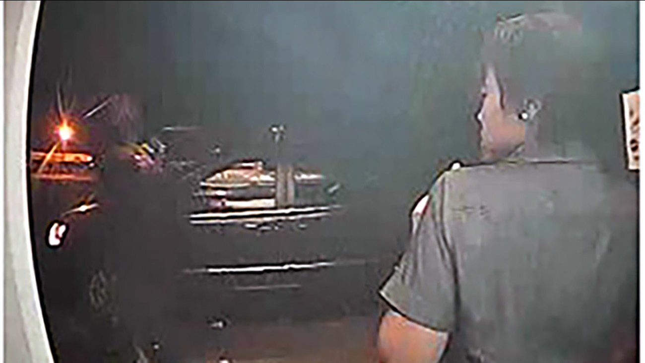 Surveillance camera image of the robbery suspect and the victim. Fayetteville ATM