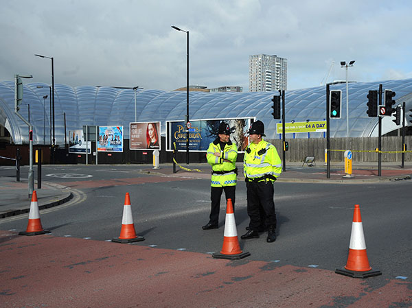 <div class='meta'><div class='origin-logo' data-origin='none'></div><span class='caption-text' data-credit='Rui Vieira/AP Photo'>Police block a road outside the Manchester Arena in central Manchester, England Tuesday May 23, 2017.</span></div>