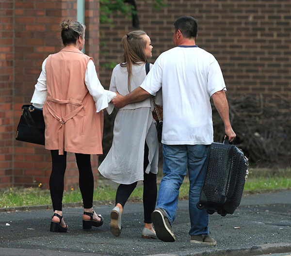 <div class='meta'><div class='origin-logo' data-origin='none'></div><span class='caption-text' data-credit='Rui Vieira/AP Photo'>A fan leaves with parents at the Park Inn hotel in central Manchester, England Tuesday May 23 2017.</span></div>