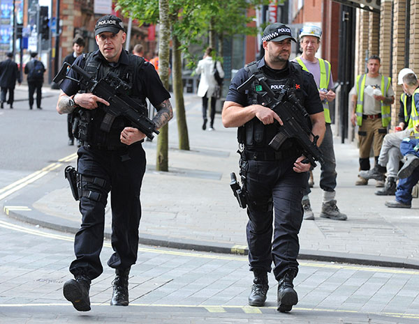<div class='meta'><div class='origin-logo' data-origin='none'></div><span class='caption-text' data-credit='Rui Vieira/AP Photo'>Armed police patrol the streets near to Manchester Arena in central Manchester, England, Tuesday May 23, 2017.</span></div>