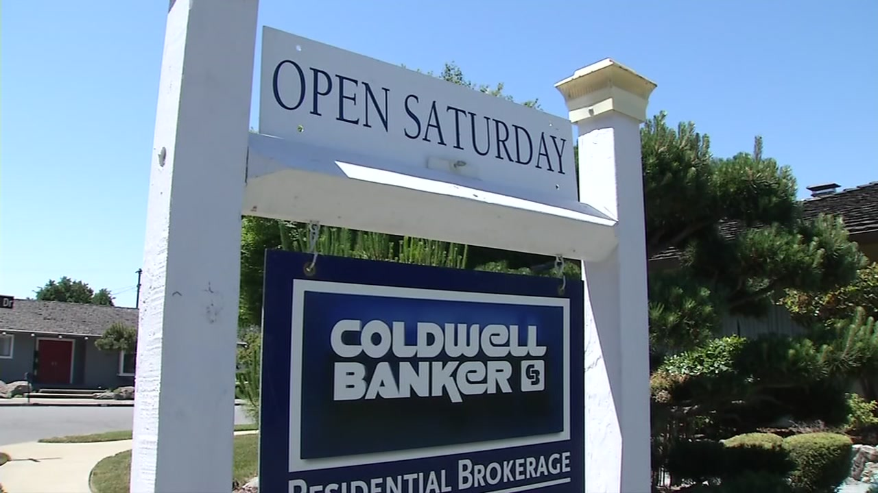 A real estate sign promoting an open house is posted in front of a San Jose, Calif. home on Tuesday, May 23, 2017.