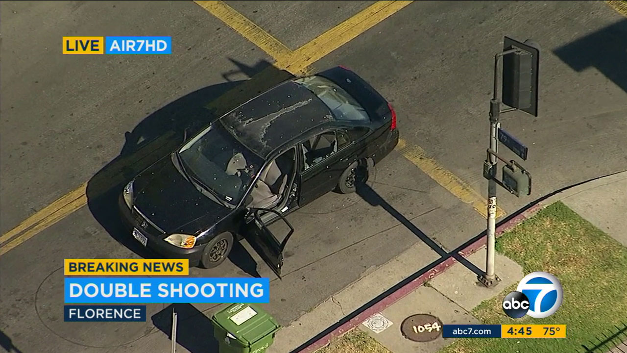 A Honda with its windows shot out was at the scene of a double shooting in the Florence neighborhood of South Los Angeles on Tuesday, May 23, 2017.