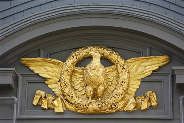 """<div class=""""meta image-caption""""><div class=""""origin-logo origin-image ap""""><span>AP</span></div><span class=""""caption-text"""">A gold-leaf covered eagle on the exterior of President Theodore Roosevelt's 28-room Sagamore Hill mansion that served as his """"Summer White House"""" in Oyster Bay, N.Y. (AP Photo/Kathy Willens)</span></div>"""
