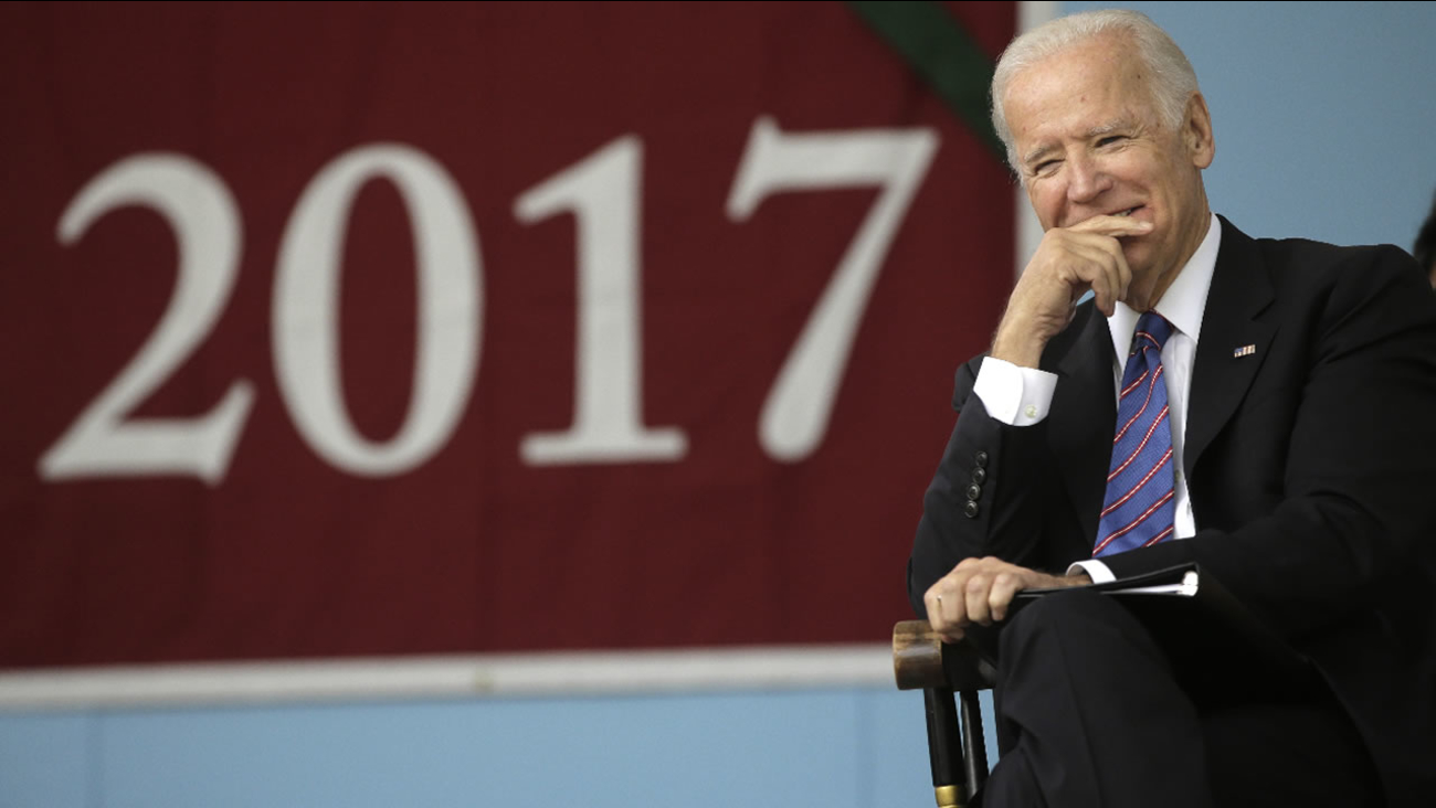 Joe Biden listens while seated on the stage during 2017 Harvard College Class Day exercises, Wednesday, May 24, 2017, at Harvard University, in Cambridge, Mass.
