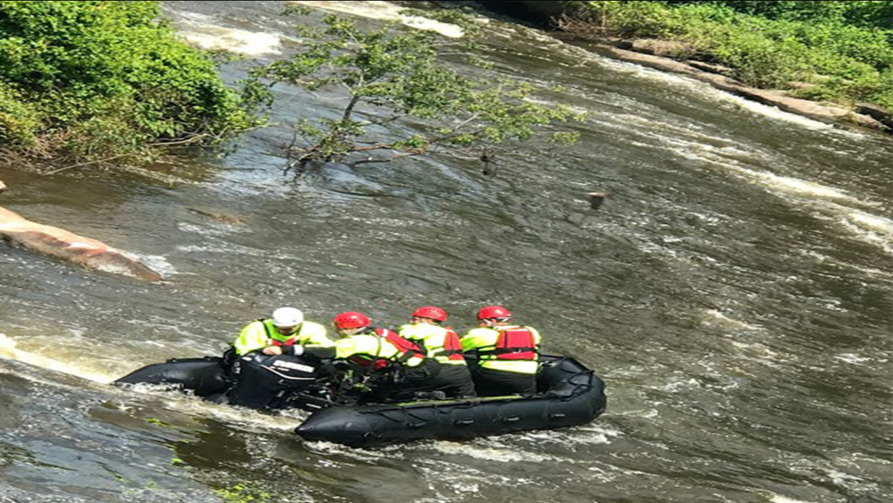 According to the Wake Forest Fire Department, a couple was by a dam when the woman's kayak got caught in some branches and tipped over.