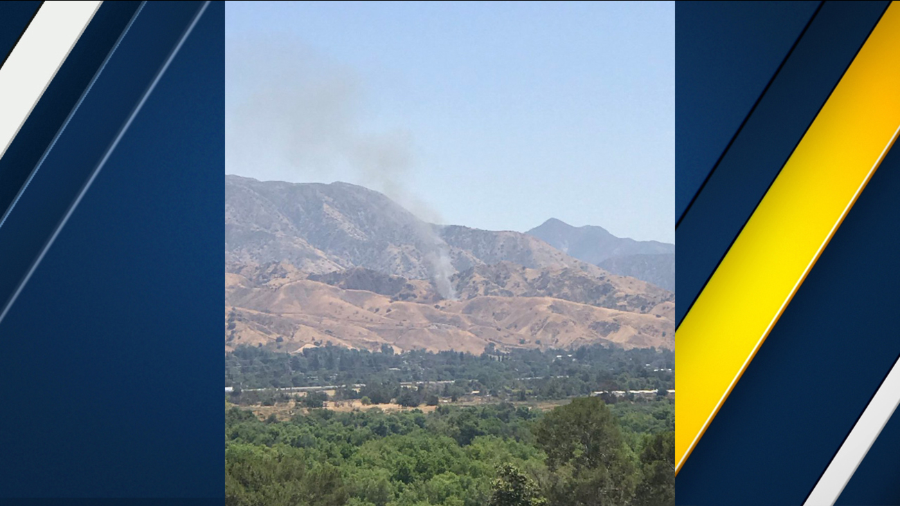 Smoke is seen rising above Sylmar's Lopez Canyon as firefighters battled a brush fire on Sunday, May 28, 2017.