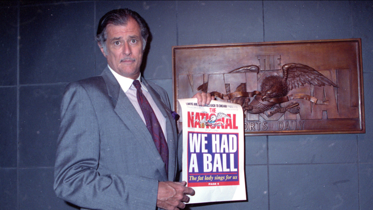 Frank Deford holds a proof of the final front page of the newspaper after a news conference at the paper's offices in New York City on Wednesday, June 12, 1991.
