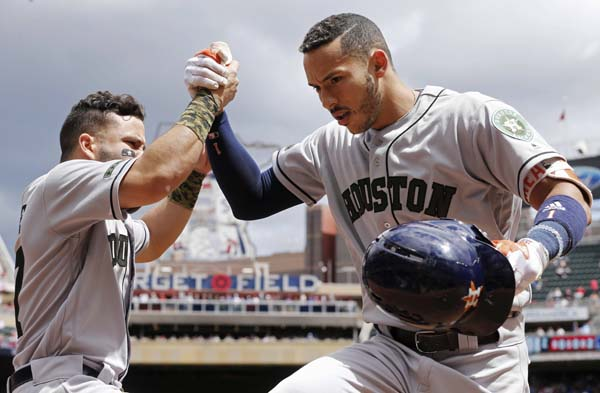 "<div class=""meta image-caption""><div class=""origin-logo origin-image ap""><span>AP</span></div><span class=""caption-text"">Houston Astros' Carlos Correa, right, is congratulated by Jose Altuve following his solo home run off Minnesota Twins pitcher Ervin Santana, left(AP Photo/Jim Mone) (AP)</span></div>"