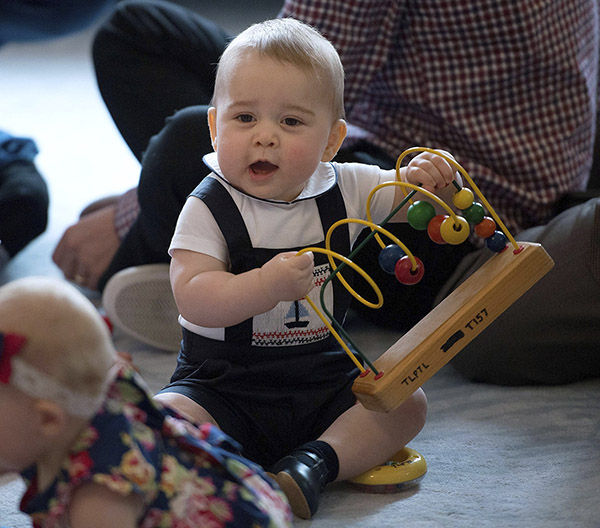"<div class=""meta image-caption""><div class=""origin-logo origin-image ""><span></span></div><span class=""caption-text"">Britain's Prince George plays with other local families and babies during a visit to Plunket nurse and parents group at Government House in Wellington, New Zealand. (Marty Melville / AP)</span></div>"