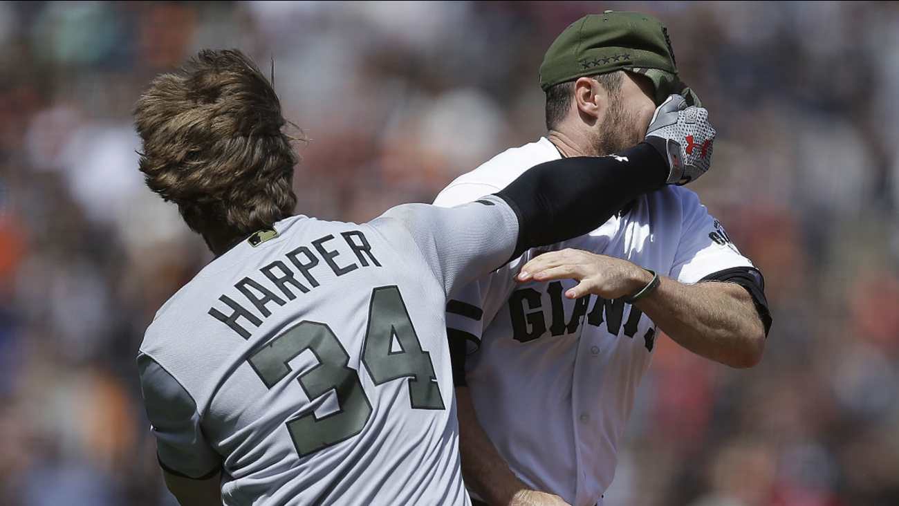 Nationals' Bryce Harper hits Giants' Hunter Strickland in the face after being hit with a pitch in the eighth inning of a baseball game Monday, May 29, 2017 in San Francisco.