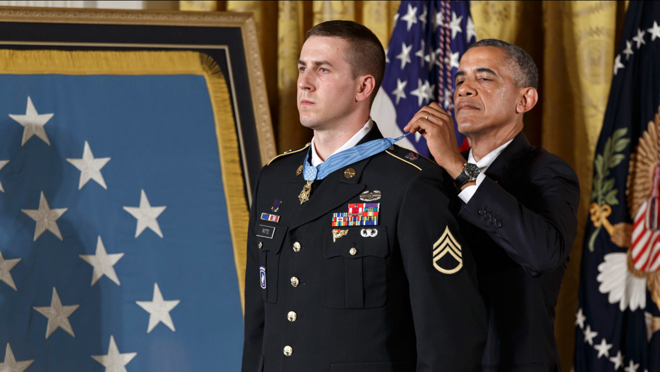 President Barack Obama bestows the Medal of Honor, the nation's highest decoration for battlefield valor, to Ryan M. Pitts, 28, of Nashua, NH, in Washington, Monday, July 21, 2014.