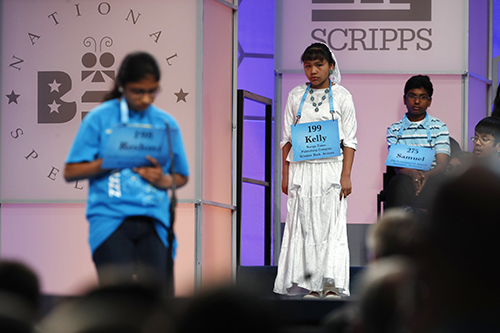 "<div class=""meta image-caption""><div class=""origin-logo origin-image ap""><span>AP</span></div><span class=""caption-text"">Kelly Haven, 12, of Fort Defiance, Ariz., center, who is sponsored by the Navajo Times, waits to compete in the 90th Scripps National Spelling Bee in Oxon Hill, Md. (AP Photo/Jacquelyn Martin)</span></div>"