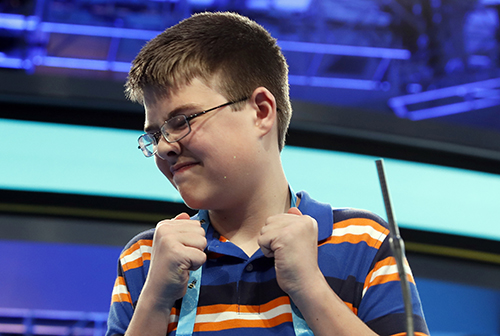 "<div class=""meta image-caption""><div class=""origin-logo origin-image ap""><span>AP</span></div><span class=""caption-text"">Joel Miles, 14, from Greenwood, Mo., reacts after spelling his word correctly in the third round of the 90th Scripps National Spelling Bee, Wednesday, May 31, 2017. (AP Photo/Alex Brandon)</span></div>"