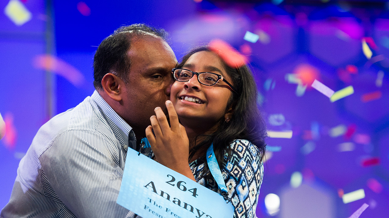 Ananya Vinay, 12, from Fresno, Calif., is kissed by her father moments after winning the 90th Scripps National Spelling Bee in Oxon Hill, Md., Thursday, June 1, 2017.