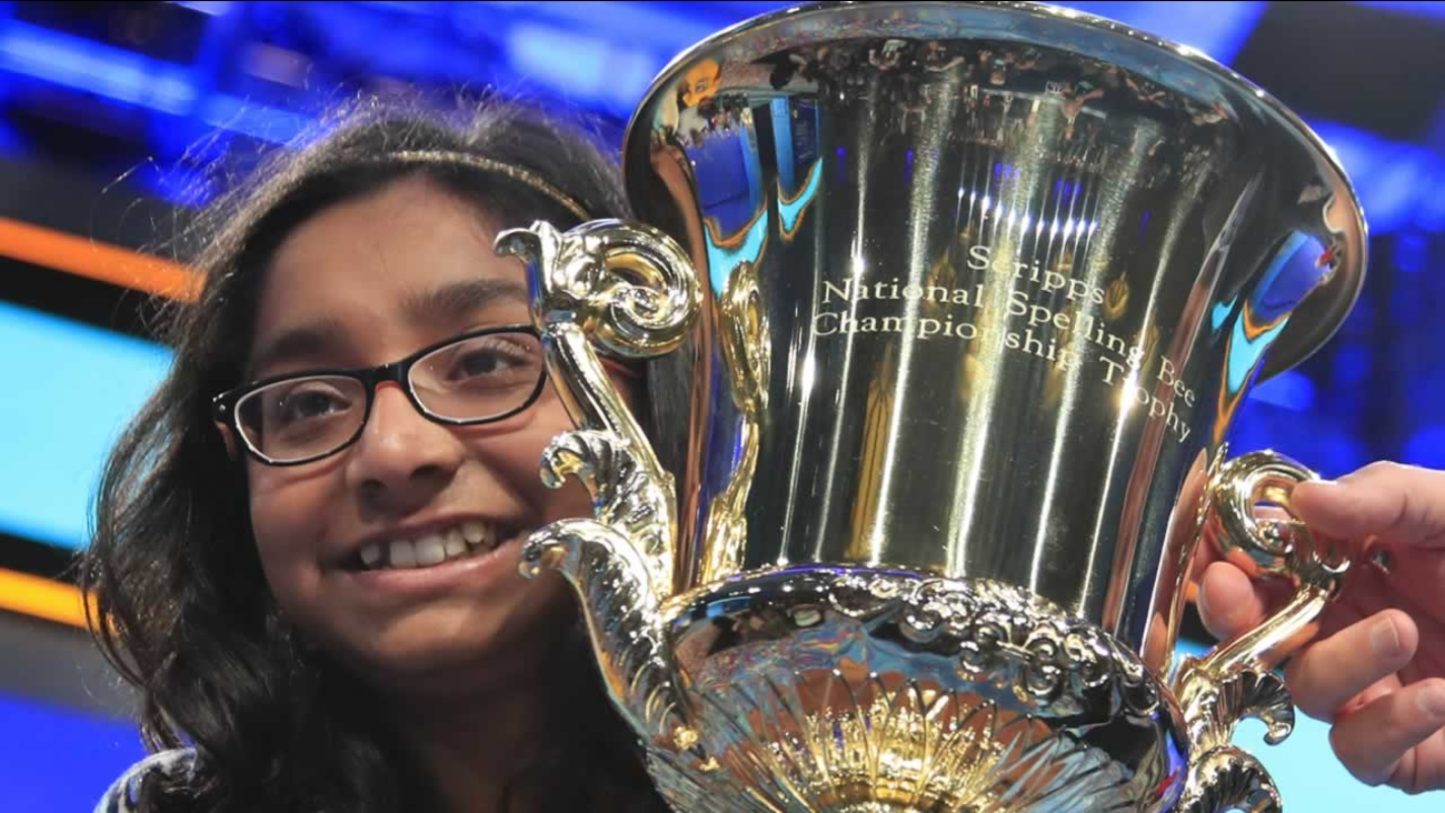 Ananya Vinay, 12, from Fresno, Calif., holds the trophy after being declared the winner of the 90th Scripps National Spelling Bee, in Oxon Hill, Md., Thursday, June 1, 2017.