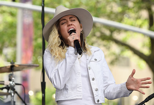 <div class='meta'><div class='origin-logo' data-origin='none'></div><span class='caption-text' data-credit='Evan Agostini/Invision/AP, File'>Miley Cyrus will join Ariana Grande at a charity concert called &#34;One Love Manchester&#34; in Manchester, England, Sunday, June 4, 2017.</span></div>