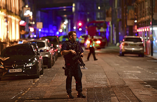 "<div class=""meta image-caption""><div class=""origin-logo origin-image ap""><span>AP</span></div><span class=""caption-text"">An armed policeman stands on Borough High Street as police are dealing with an incident on London Bridge in London, Saturday, June 3, 2017. (Dominic Lipinski/PA via AP)</span></div>"