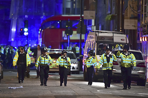 "<div class=""meta image-caption""><div class=""origin-logo origin-image ap""><span>AP</span></div><span class=""caption-text"">Police officers on Borough High Street as police are dealing with an incident on London Bridge in London, Saturday, June 3, 2017. (Dominic Lipinski/PA via AP)</span></div>"