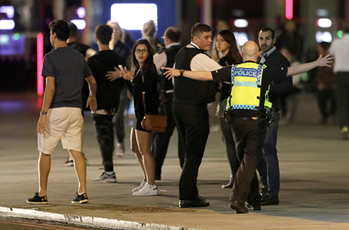 <div class='meta'><div class='origin-logo' data-origin='AP'></div><span class='caption-text' data-credit='AP Photo/ Matt Dunham'>A Police officer clears people away from the area near London Bridge after an incident in central London, late Saturday, June 3, 2017.</span></div>