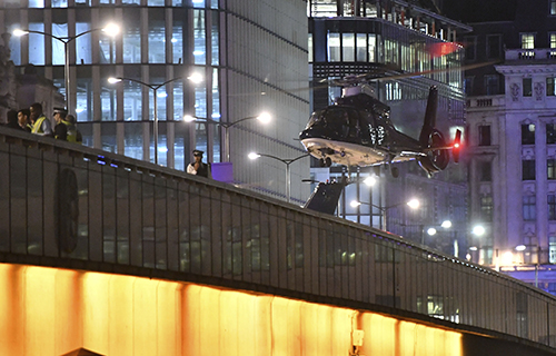 <div class='meta'><div class='origin-logo' data-origin='AP'></div><span class='caption-text' data-credit='Dominic Lipinski/PA via AP'>An helicopter lands on London Bridge after an attack in central London, Saturday, June 3, 2017.</span></div>