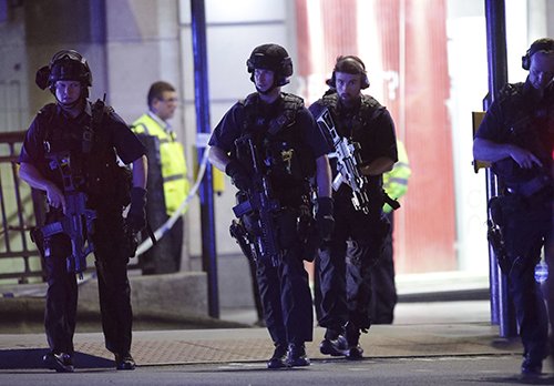 "<div class=""meta image-caption""><div class=""origin-logo origin-image ap""><span>AP</span></div><span class=""caption-text"">Armed police outside Monument station after an incident in central London, Saturday, June 3, 2017.  British police said they were dealing with ""incidents."" (Yui Mok/PA via AP)</span></div>"