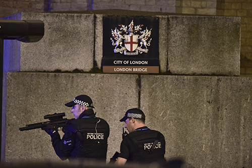 "<div class=""meta image-caption""><div class=""origin-logo origin-image ap""><span>AP</span></div><span class=""caption-text"">An armed Police officer looks through his weapon on London Bridge in London, Saturday, June 3, 2017. (Dominic Lipinski/PA via AP)</span></div>"