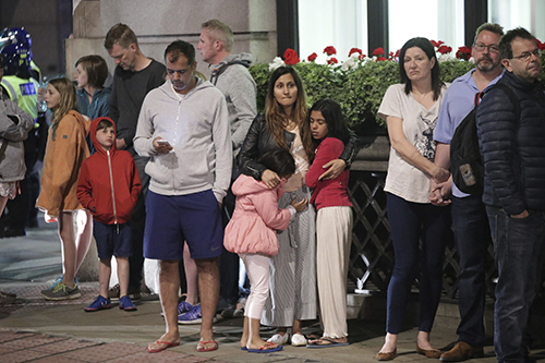 "<div class=""meta image-caption""><div class=""origin-logo origin-image ap""><span>AP</span></div><span class=""caption-text"">Guests from the Premier Inn Bankside Hotel are evacuated and kept in a group with police on Upper Thames Street following an incident in central London, Saturday, June 3, 2017. (Yui Mok/PA via AP)</span></div>"