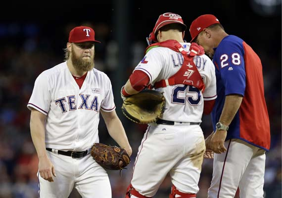 "<div class=""meta image-caption""><div class=""origin-logo origin-image ap""><span>AP</span></div><span class=""caption-text"">Texas Rangers' Andrew Cashner, left, talks with catcher Jonathan Lucroy and manager Jeff Banister, right, on the mound during a game against the Astros(AP Photo/Tony Gutierrez) (AP)</span></div>"