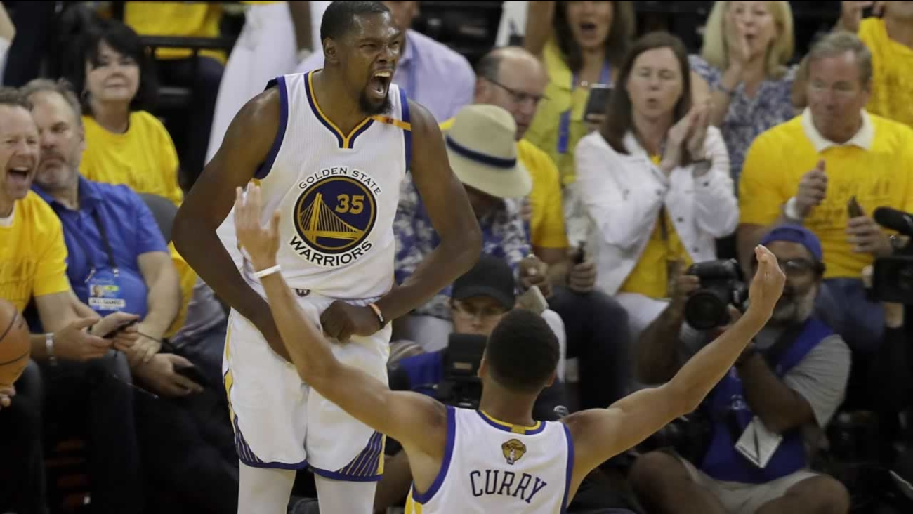 The Warriors' Kevin Durant celebrates with Stephen Curry during Game 2 of the NBA Finals against the Cavaliers in Oakland, Calif., Sunday, June 4, 2017.
