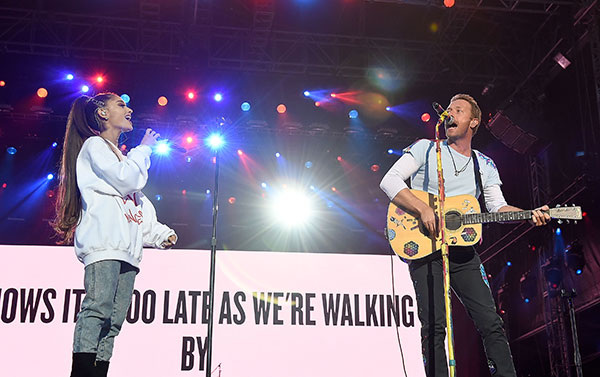 """<div class=""""meta image-caption""""><div class=""""origin-logo origin-image none""""><span>none</span></div><span class=""""caption-text"""">Ariana Grande and Chris Martin perform on stage during the One Love Manchester Benefit Concert at Old Trafford on June 4, 2017 in Manchester, England. (Kevin Mazur/One Love Manchester/Getty Images for One Love Manchester)</span></div>"""
