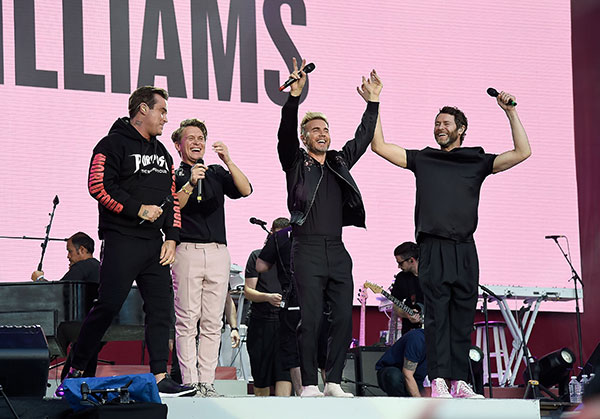 "<div class=""meta image-caption""><div class=""origin-logo origin-image none""><span>none</span></div><span class=""caption-text"">Robbie Williams with Howard Donald, Gary Barlow and Mark Owen of Manchester band Take That on stage during the One Love Manchester Benefit Concert. (Kevin Mazur/One Love Manchester/Getty Images for One Love Manchester)</span></div>"