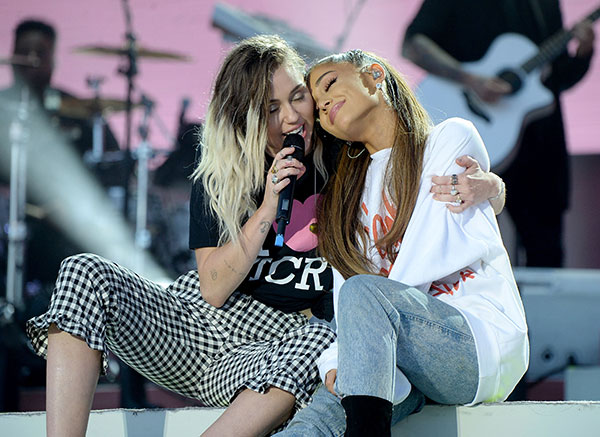 "<div class=""meta image-caption""><div class=""origin-logo origin-image none""><span>none</span></div><span class=""caption-text"">Ariana Grande (R) and Miley Cyrus perform on stage during the One Love Manchester Benefit Concert at Old Trafford on June 4, 2017 in Manchester, England. (Kevin Mazur/One Love Manchester/Getty Images for One Love Manchester)</span></div>"