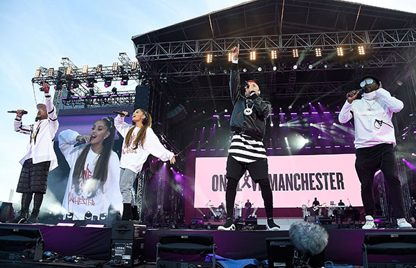 "<div class=""meta image-caption""><div class=""origin-logo origin-image none""><span>none</span></div><span class=""caption-text"">Ariana Grande performs on stage with Taboo (2nd R) apl.de.ap (L) and will.i.am (R) of The Black Eyed Peas during the One Love Manchester Benefit Concert at Old Trafford on June 4. (Kevin Mazur/One Love Manchester/Getty Images for One Love Manchester)</span></div>"