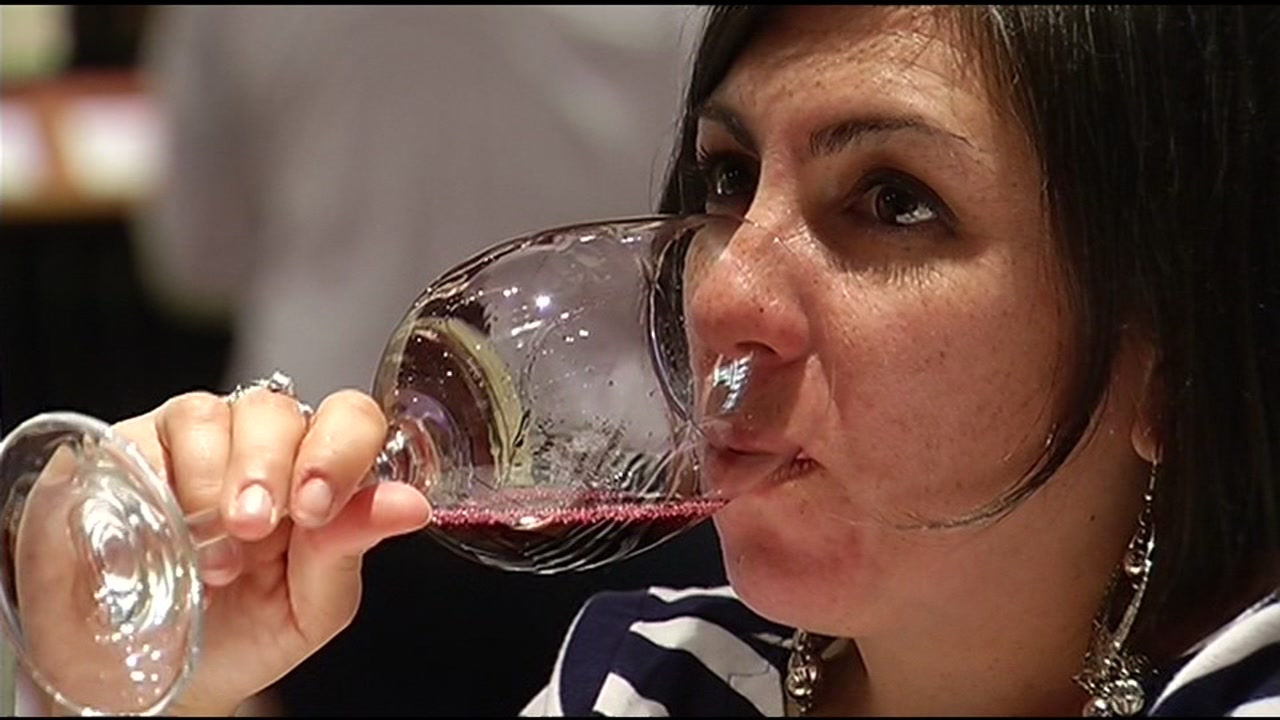 A woman enjoys a red wine in this undated photo.