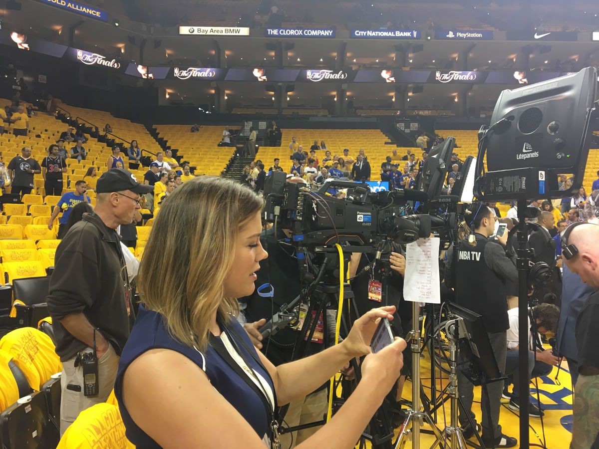 <div class='meta'><div class='origin-logo' data-origin='none'></div><span class='caption-text' data-credit='KGO-TV'>ABC7 News reporter Katie Utehs snaps a photo courtside at game 2 of the NBA Finals in Oakland, Calif. on Sunday, June 4, 2017.</span></div>