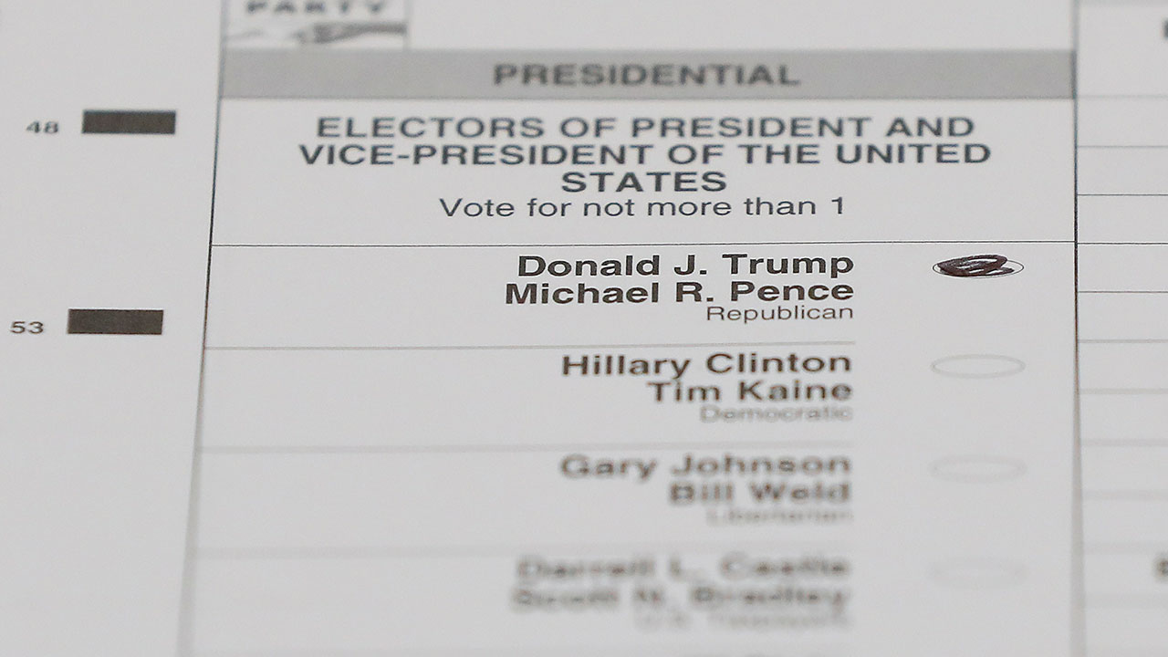 FILE - In this Dec. 5, 2016, file photo, a ballot with a vote for Donald J. Trump is shown during a statewide presidential election recount in Waterford Township, Mich.