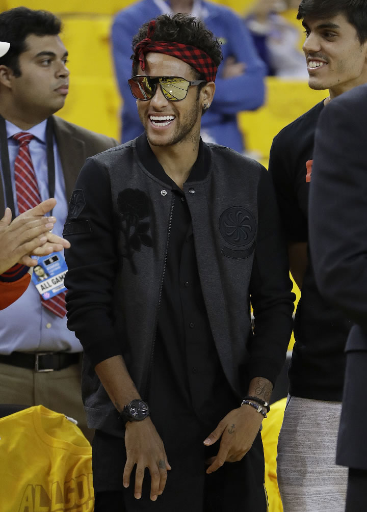 <div class='meta'><div class='origin-logo' data-origin='none'></div><span class='caption-text' data-credit='AP Photo/Marcio Jose Sanchez'>Barcelona soccer player Neymar watches as players warm up before Game 2 of basketball's NBA Finals between the Warriors and the Cavaliers in Oakland, Calif., on June 4, 2017.</span></div>