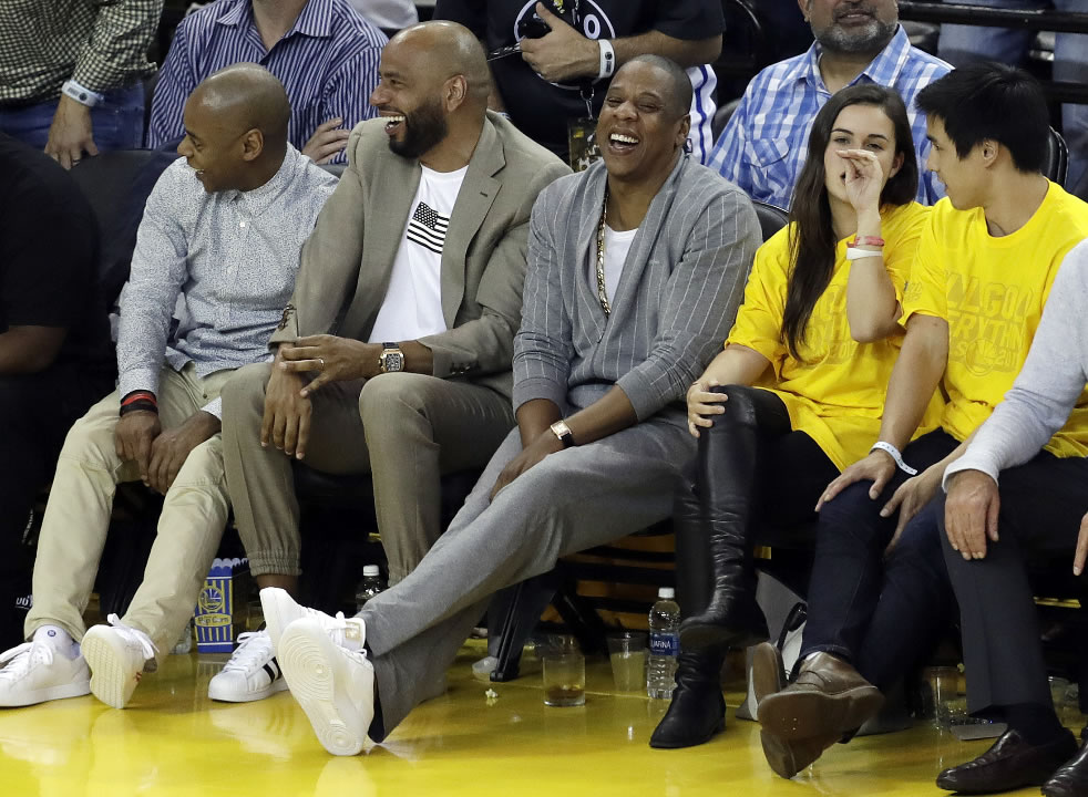 <div class='meta'><div class='origin-logo' data-origin='none'></div><span class='caption-text' data-credit='AP Photo/Marcio Jose Sanchez'>Rapper Jay-Z, center, watches Game 1 of basketball's NBA Finals between the Golden State Warriors and the Cleveland Cavaliers Thursday, June 1, 2017, in Oakland, Calif.</span></div>