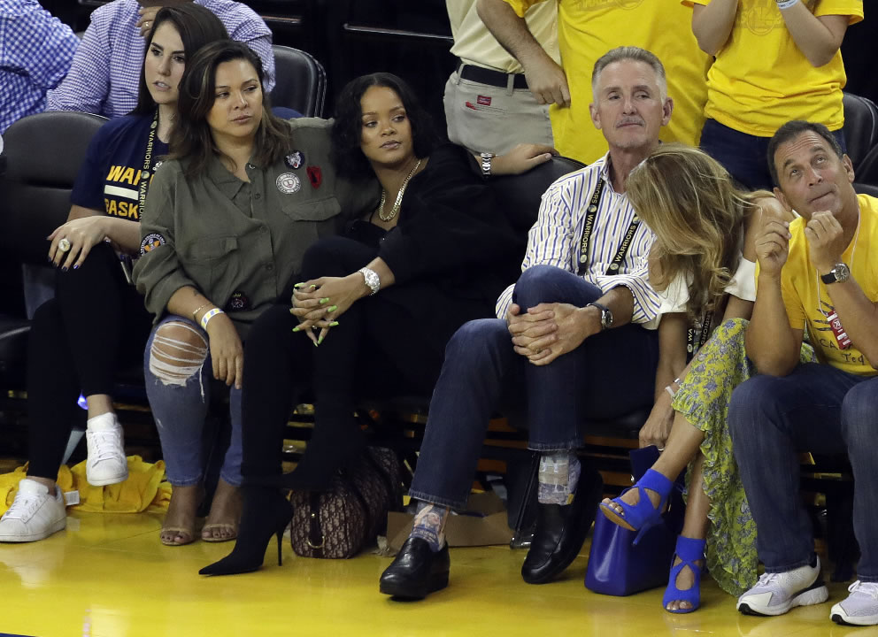 "<div class=""meta image-caption""><div class=""origin-logo origin-image none""><span>none</span></div><span class=""caption-text"">Singer Rihanna, second from left, watches Game 1 of the NBA Finals between the Golden State Warriors and the Cleveland Cavaliers Thursday, June 1, 2017, in Oakland, Calif. (AP Photo/Marcio Jose Sanchez)</span></div>"