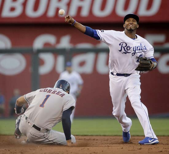 """<div class=""""meta image-caption""""><div class=""""origin-logo origin-image ap""""><span>AP</span></div><span class=""""caption-text"""">Royals shortstop Alcides Escobar throws to first too late for the double play after forcing Astros' Carlos Correa (1) out at second on a force out hit into by Carlos Beltran. (Charlie Riedel)</span></div>"""