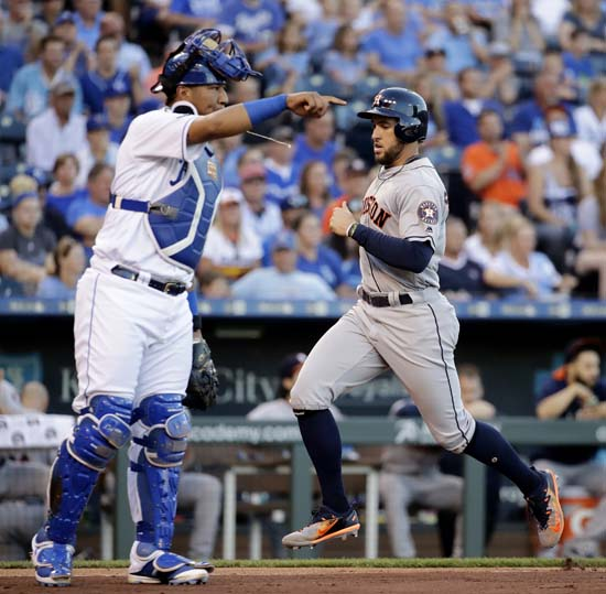 """<div class=""""meta image-caption""""><div class=""""origin-logo origin-image ap""""><span>AP</span></div><span class=""""caption-text"""">Houston Astros' George Springer runs home to score past Kansas City Royals catcher Salvador Perez on a sacrifice fly by Jose Altuve during the third inning of a baseball game. (Charlie Riedel)</span></div>"""