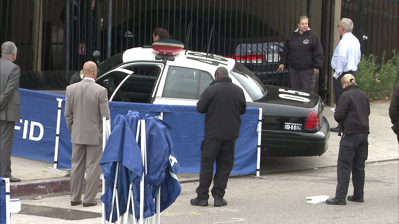 Authorities covered up an LAPD patrol car on Wednesday, June 7, 2017, after an officer-involved shooting broke out in Wilmington the night before.