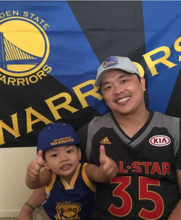 "<div class=""meta image-caption""><div class=""origin-logo origin-image none""><span>none</span></div><span class=""caption-text"">A young Warriors fan gives a thumbs up with his dad in this photo shared on Thursday, June 8, 2017. (Photo by Ferdinand Garcia/Facebook)</span></div>"