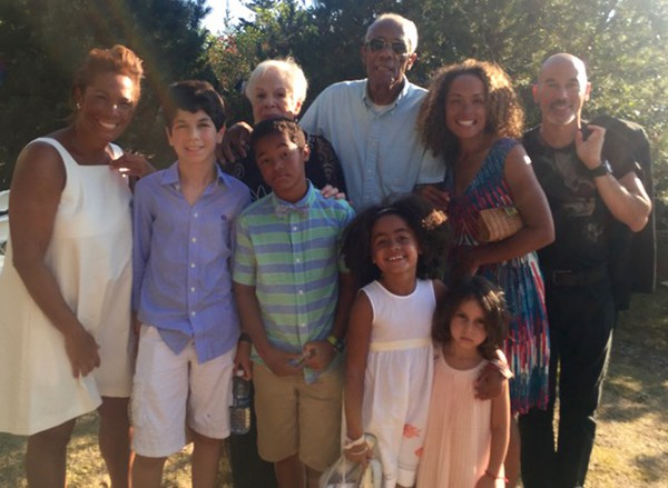<div class='meta'><div class='origin-logo' data-origin='none'></div><span class='caption-text' data-credit=''>Kemberly Richardson and her dad (middle) and family.</span></div>