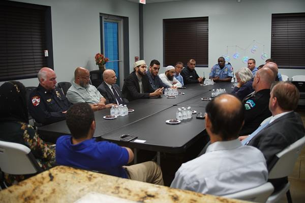"<div class=""meta image-caption""><div class=""origin-logo origin-image none""><span>none</span></div><span class=""caption-text"">The Islamic Association of Raleigh hosted law enforcement officers from across the state</span></div>"