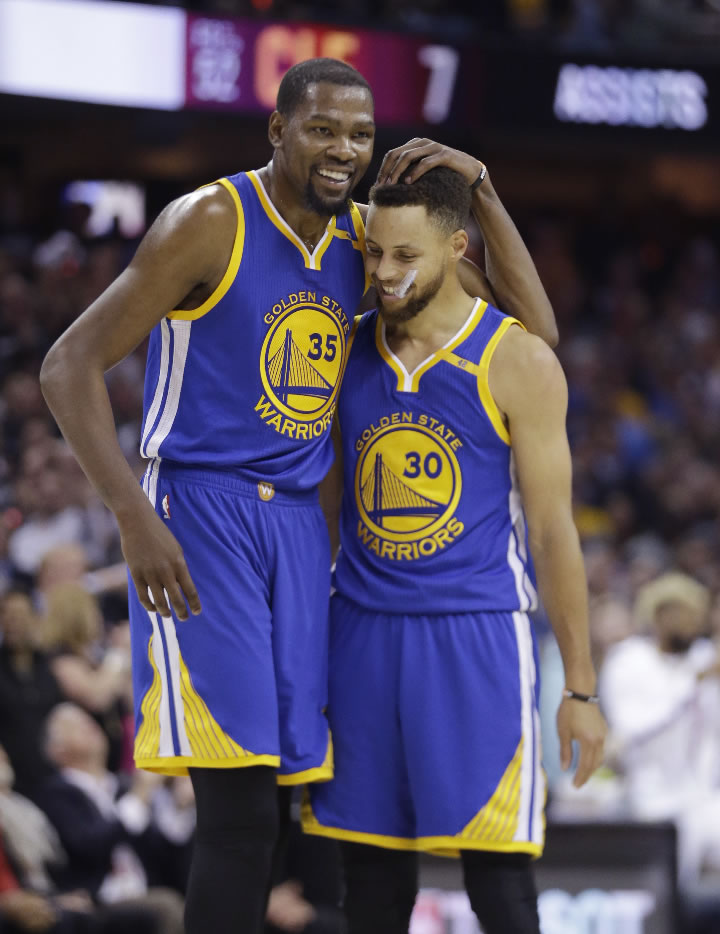 "<div class=""meta image-caption""><div class=""origin-logo origin-image none""><span>none</span></div><span class=""caption-text"">Warriors' Kevin Durant (35) hugs Stephen Curry (30) during the first half against the Cavaliers in Game 4 of basketball's NBA Finals in Cleveland, Friday, June 9, 2017. (AP Photo/Tony Dejak)</span></div>"