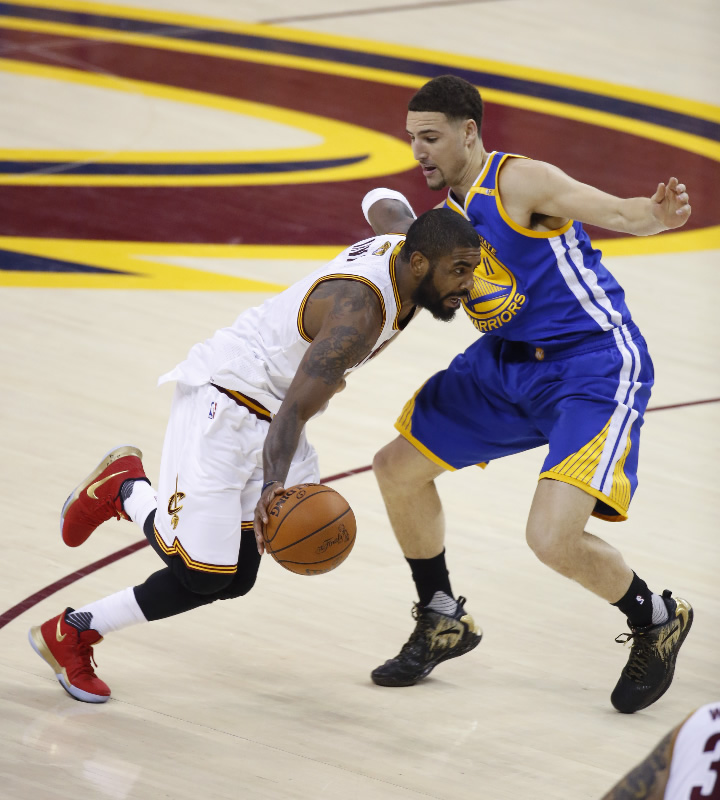 "<div class=""meta image-caption""><div class=""origin-logo origin-image none""><span>none</span></div><span class=""caption-text"">Cavaliers guard Kyrie Irving (2) drives on Golden State Warriors guard Klay Thompson (1om1) during the first half of Game 4 of basketball's NBA Finals in Cleveland on June 9, 2017. (AP Photo/Ron Schwane)</span></div>"
