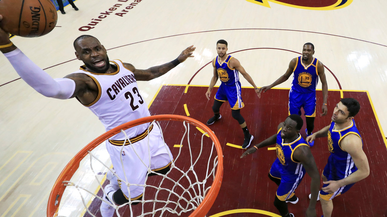 Cleveland Cavaliers forward LeBron James drives to the basket against the Golden State Warriors during the first half of Game 3 of basketball's NBA Finals in Cleveland.