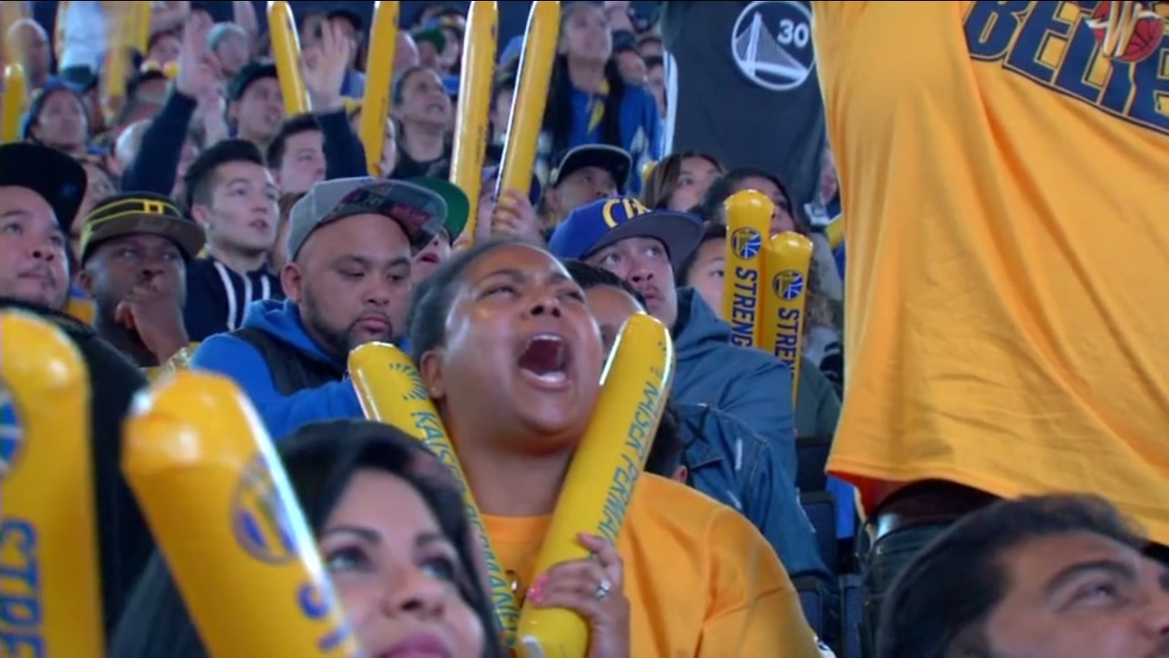 Warriors fans cheer on the Dubs at a watch party at Oracle Arena on Friday, June 9, 2017.